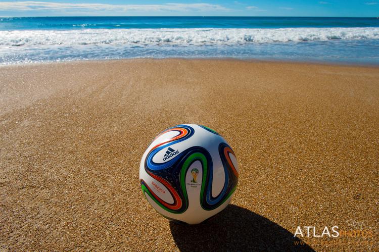 Brazuca, match ball of FIFA World Cup Brazil 2014 on a sandy beach (official Replica Ball)