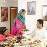 Mother serving food to family
