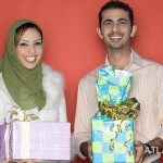 Couple holding presents