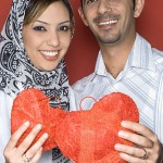Young Couple holding heart shaped object