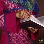 Human hand holding Koran, close-up