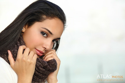 Portrait of a beautiful arab woman face warmly clothed