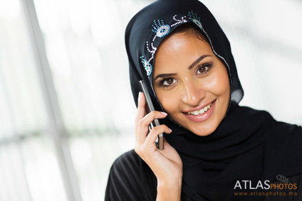 young arabian woman talking on cell phone